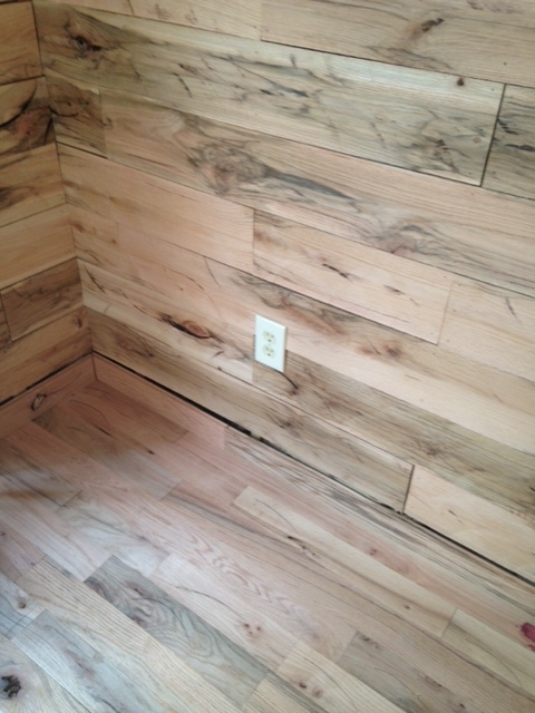Put together a few pieces of the flooring I bought, just to see how it will look. The walls and floor are both red oak.