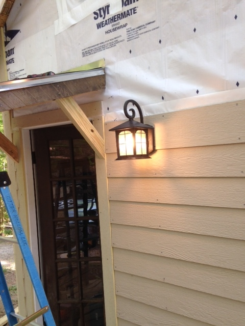 I had already run wiring for an outdoor light, so it was just a matter of making some connections and hanging this one that Shannon picked out. I like it.