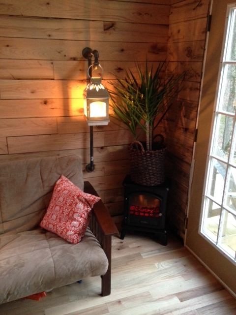 The little electric faux wood stove gives off plenty of heat for our climate. I direct wired a lantern through some matching plumbing pipe to keep the theme going throughout the house. It operates with a simple lamp twist switch at the bottom of the lantern.