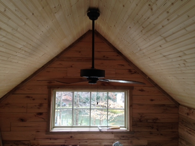 "A 52"" ceiling fan moves plenty of air around the small space."