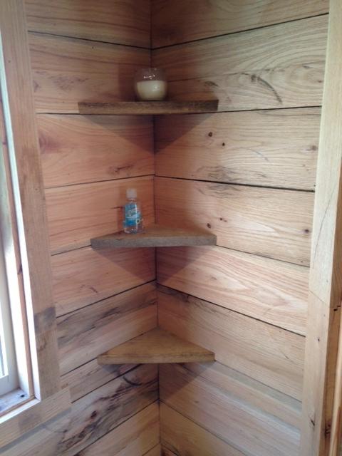 A few storage shelves from scrap red oak in the bathroom.