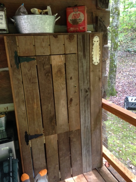 Most of the old wood from the barn was destroyed by rot and insects. I was able to save enough to build this - behind the door is the electrical panel and meter for our cabin.