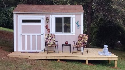 A deck, an outdoor light, some furniture and decorations make it look more like a home.