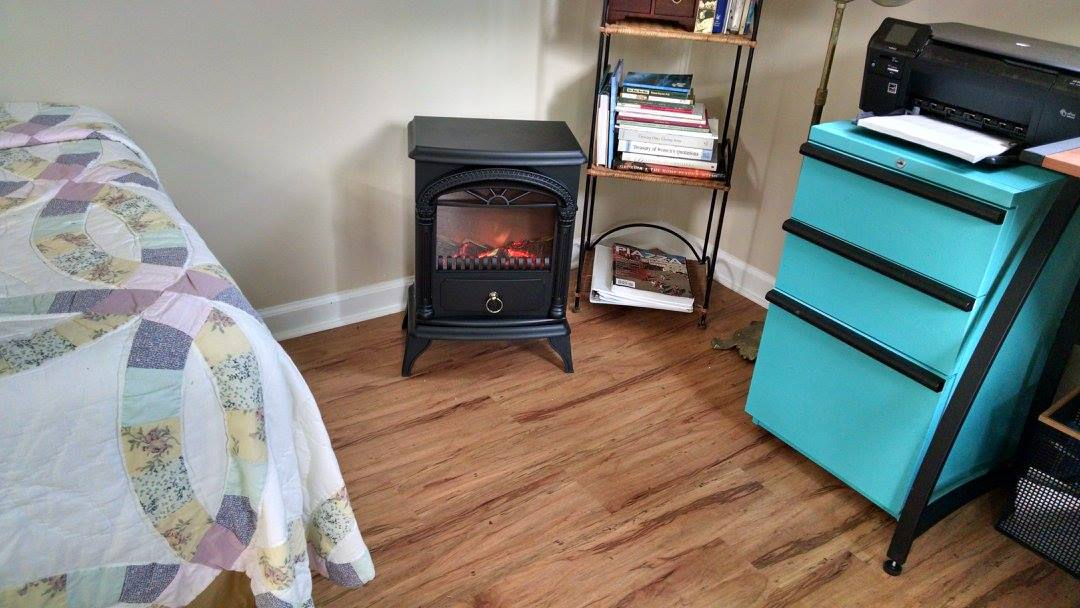 I'm a big fan of electric faux stove heaters. They add a little ambiance, and do a fine job of heating small spaces.