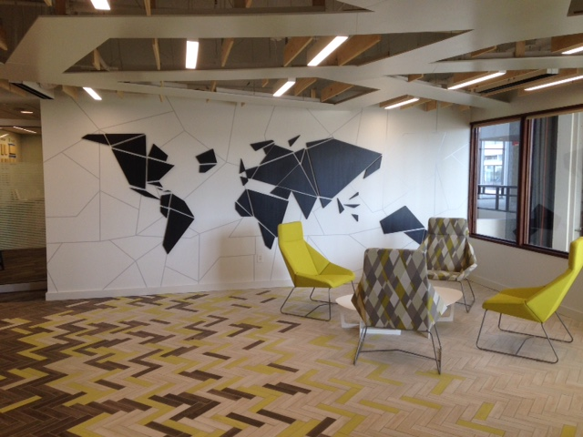 "Lobby of Arauco Wood Products. The modern map is actually 56 individual CNC-cut pieces of 3/4"" wood. We installed them with a matching CNC-cut template. Up close, the map appears to float on the wall."