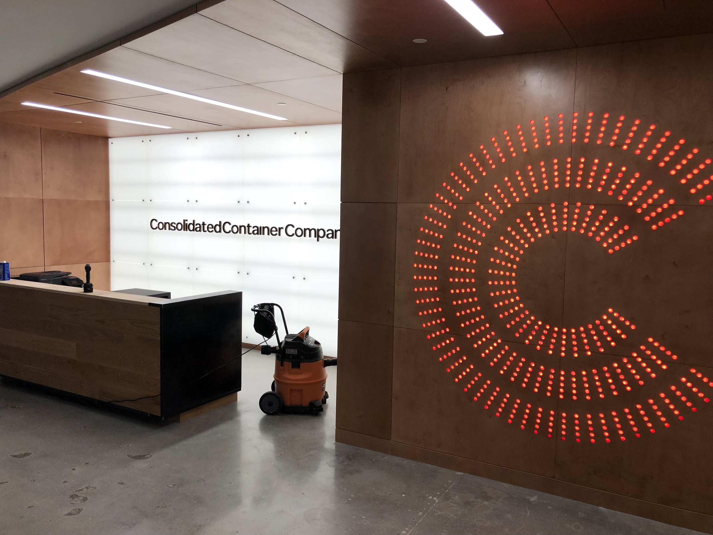 This was a fun day! We installed this 8 foot tall logo, which was CNC-machined in six different panels. The panels were put together and then sandwiched with red-tinted plexiglass between over 3,000 LED lights. We then pivoted the entire unit up onto the wall. That was a few tense moments!