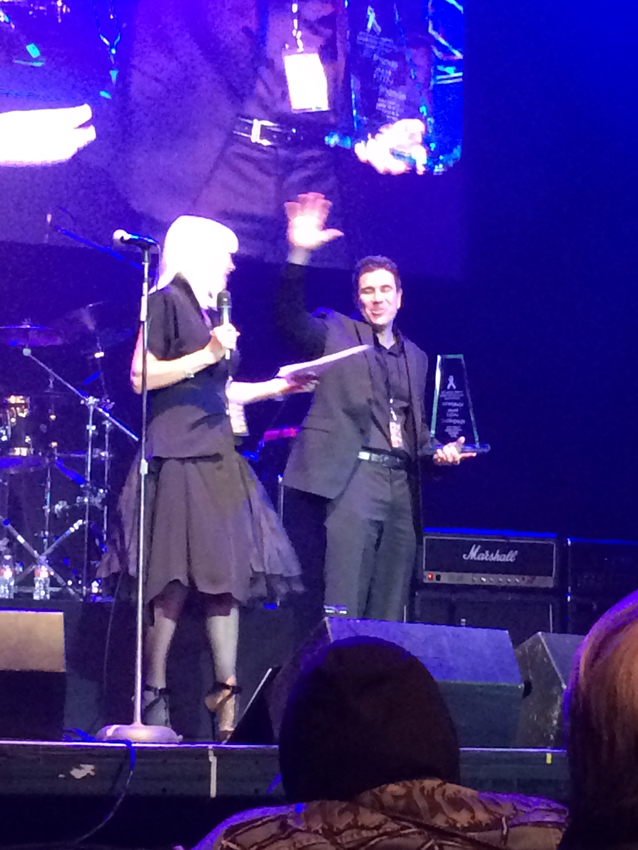 "Wendy Dio presents me with the ""Long Live Rock And Roll Award"" for creating the cover art and designing the tribute CD... which was a complete shock.  I was totally blown away."