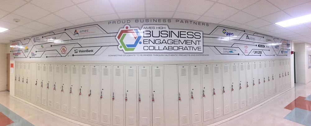 AHS-Ames-High-block-wall-wrap-business-engagement-collaborative-logos.jpg
