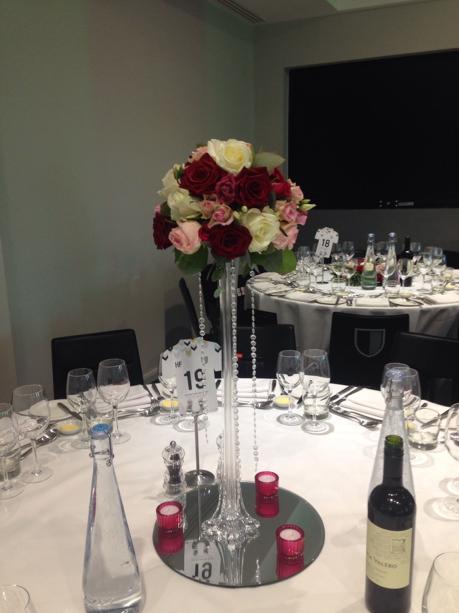 Tall mixed rose centrepiece
