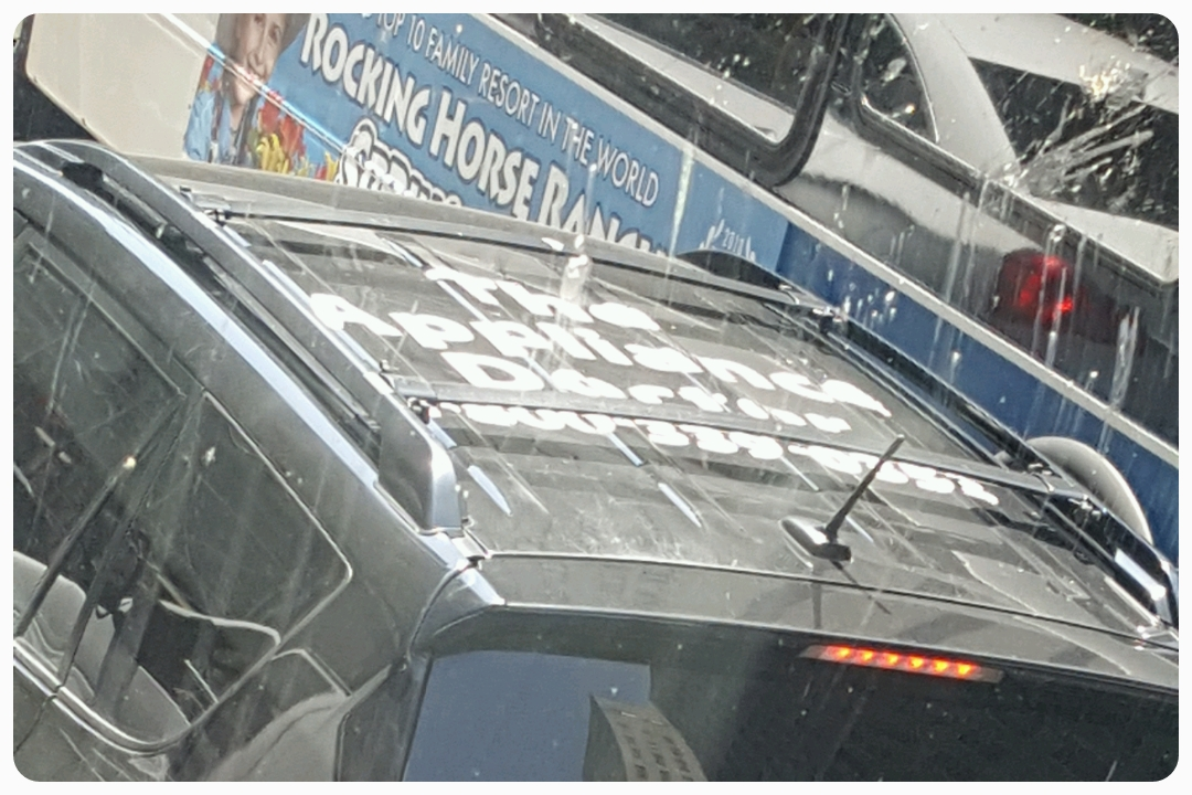 You know you're in a city of 100% highrises when they put ads on the roofs of cars.