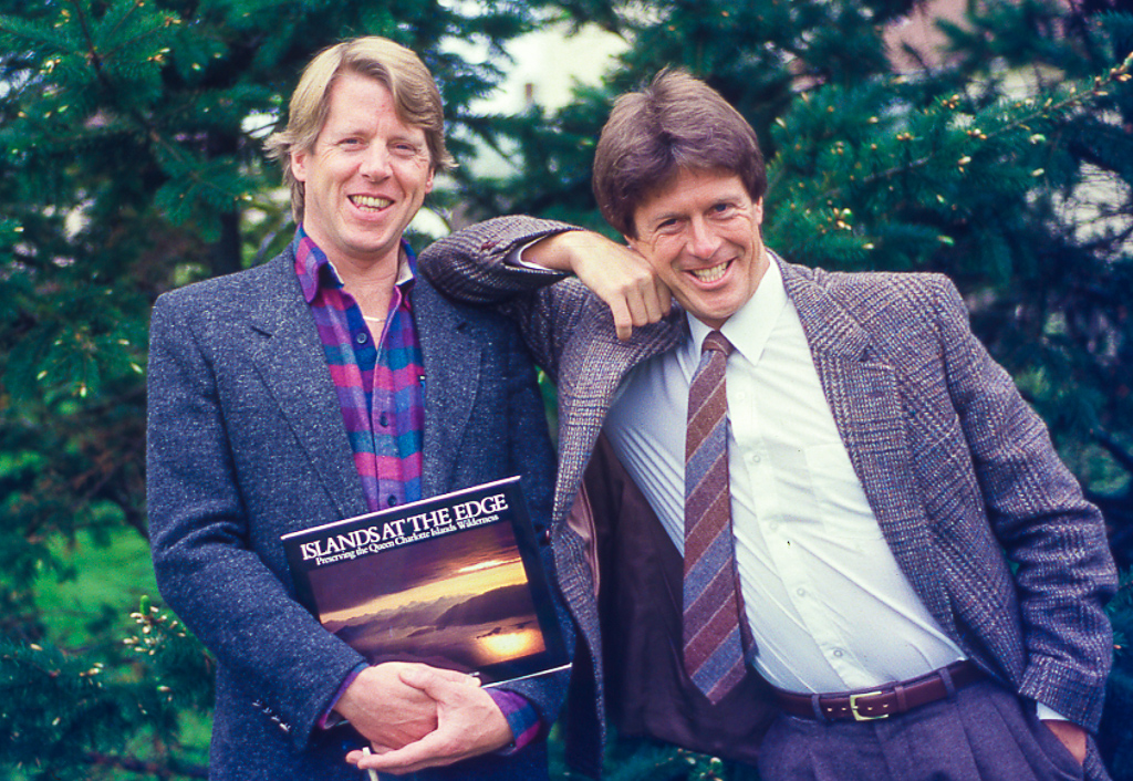 """John Broadhead (left) and Thom """"Huck"""" Henley were two essential leaders in the Gwaii Haanas campaign. They are pictured here with their seminal book  Islands at the Edge , which eloquently promoted the protection of Gwaii Haanas. It became a Canadian bestseller. Broadhead and Henley were also key mentors of Jeffrey."""