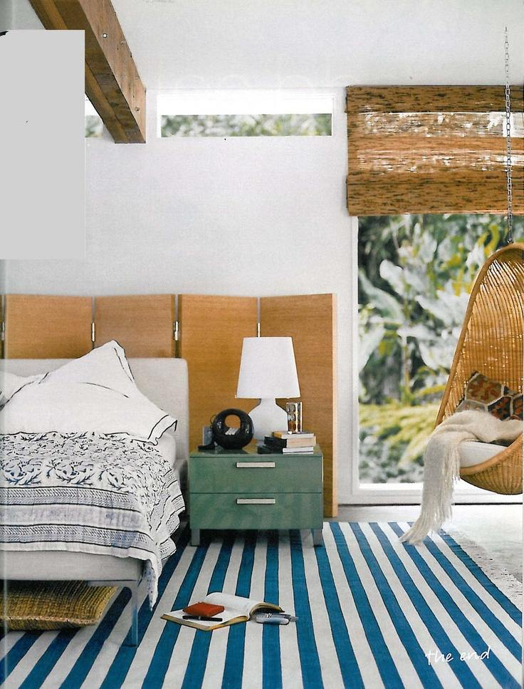 Image Credit   Casual and beachy, the classic blue and white stripes immediately sets the tone for relaxation and sunshine spilling in.