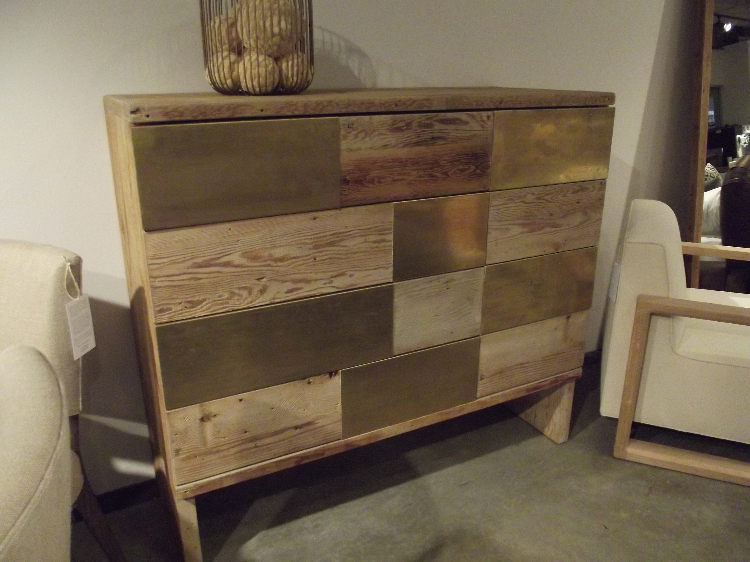 Natural wood mixed with the brass really warms the metal up on this chest!