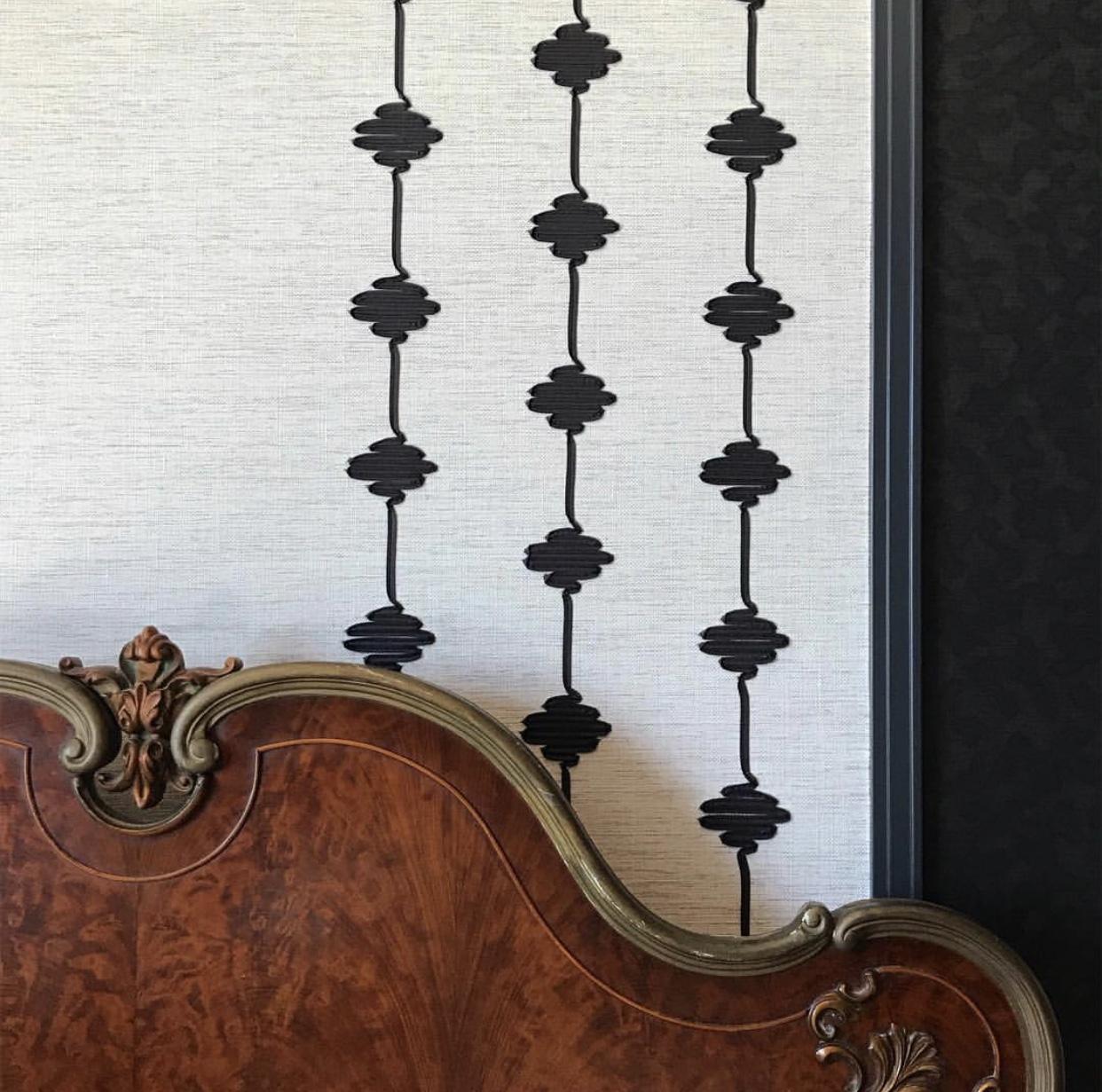 A black art deco master bedroom by Lisa Gilmore Design