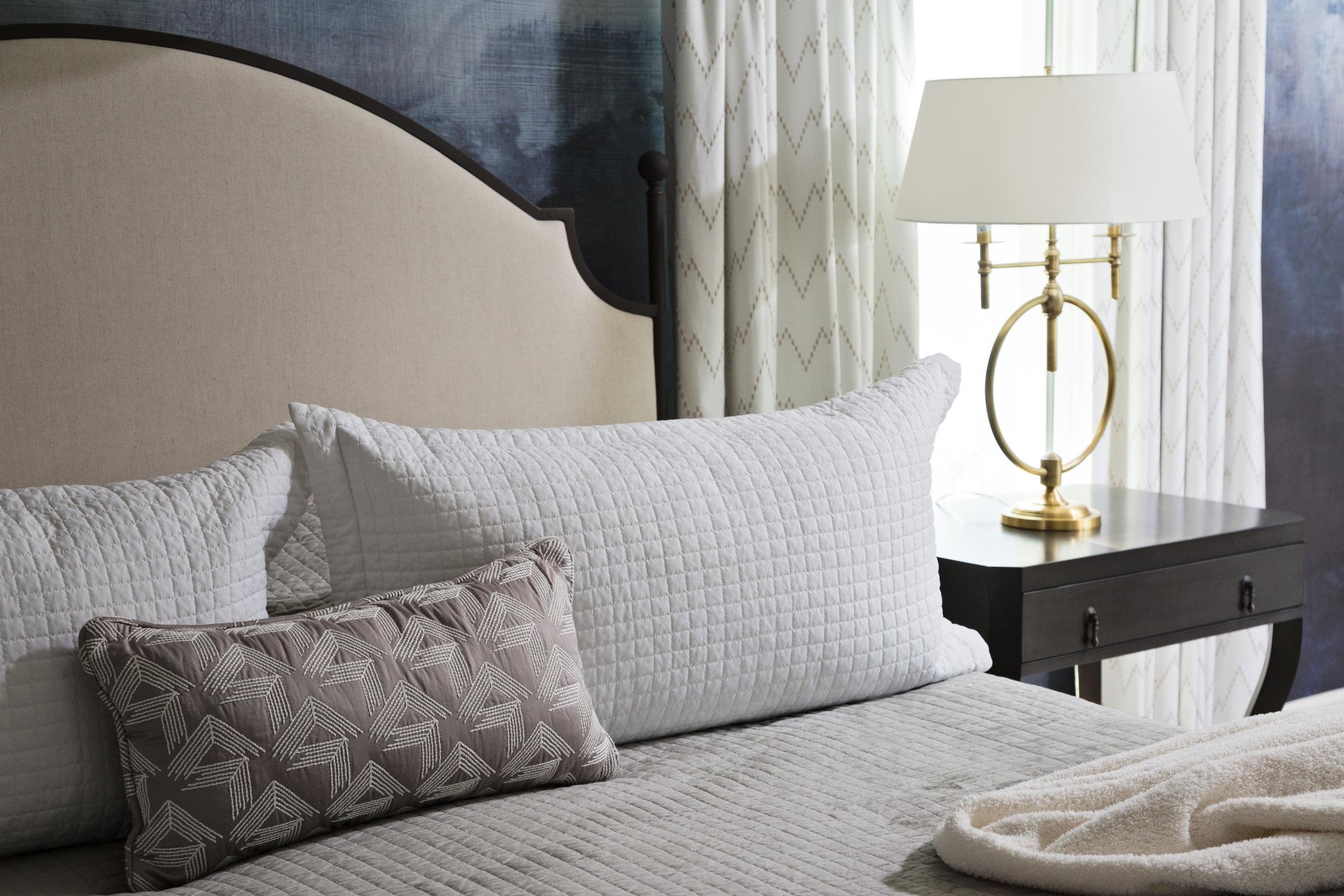 A cozy master bedroom by Lisa Gilmore Design