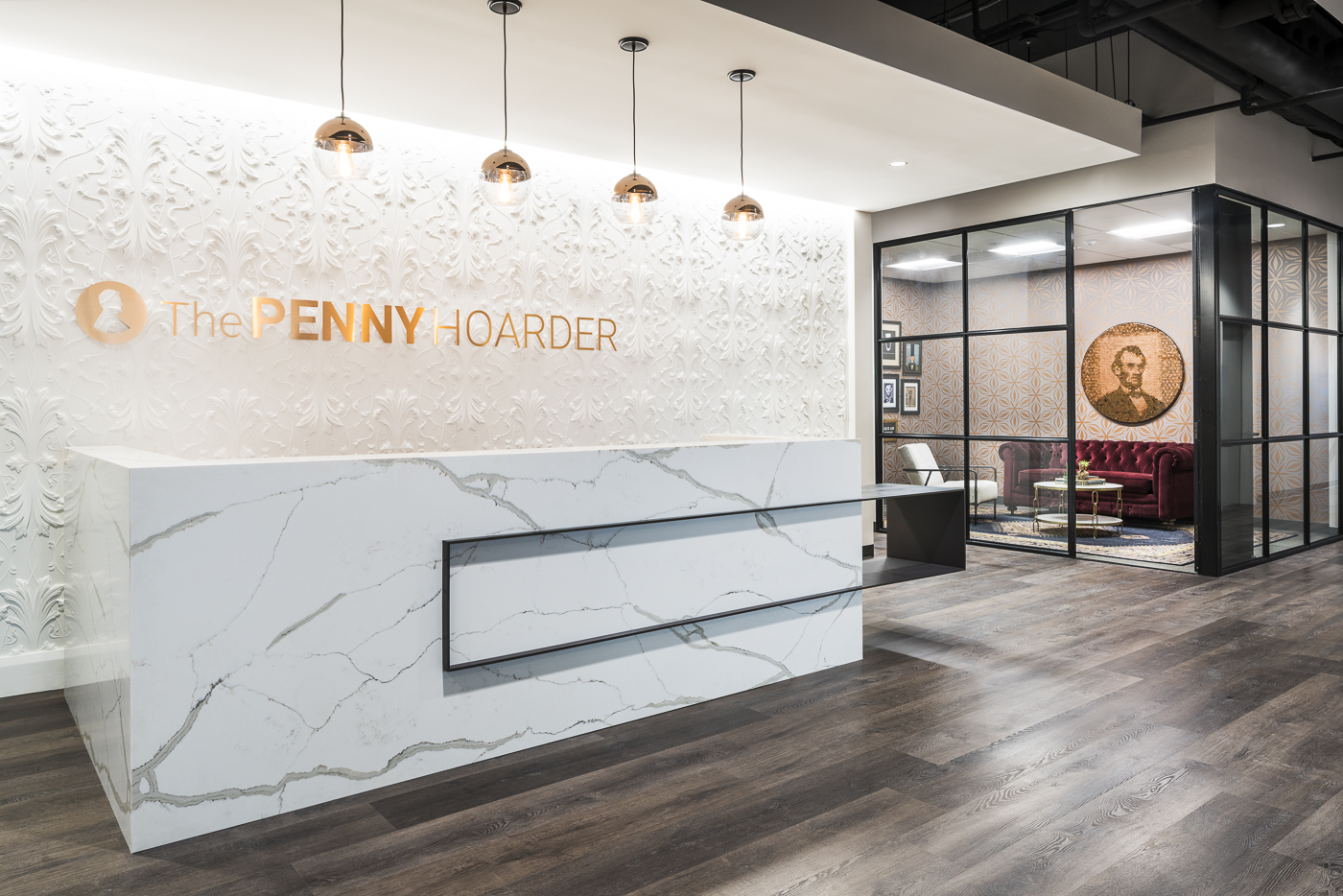 medium tone faux wood_luxury vinyl tile_commercial space_the penny hoarder