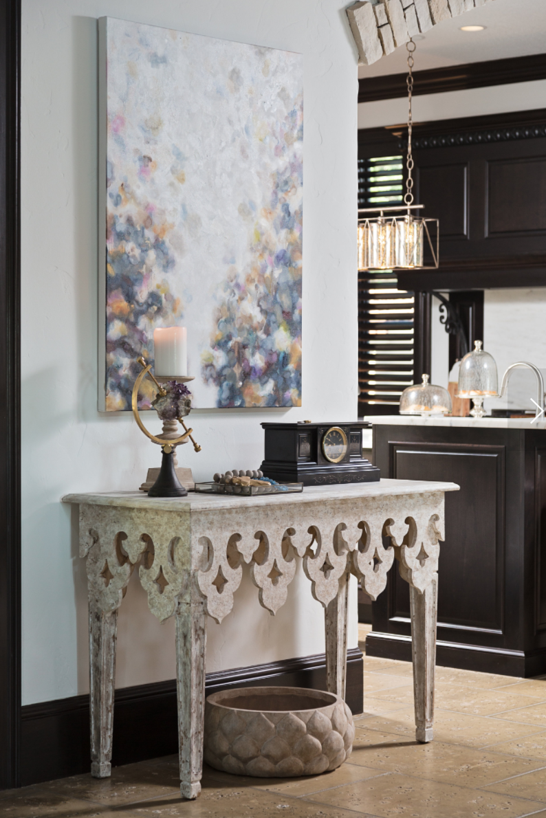 Featured artist Jules Cozine creates a custom piece for this monochromatic space- designed by Lisa Gilmore Design