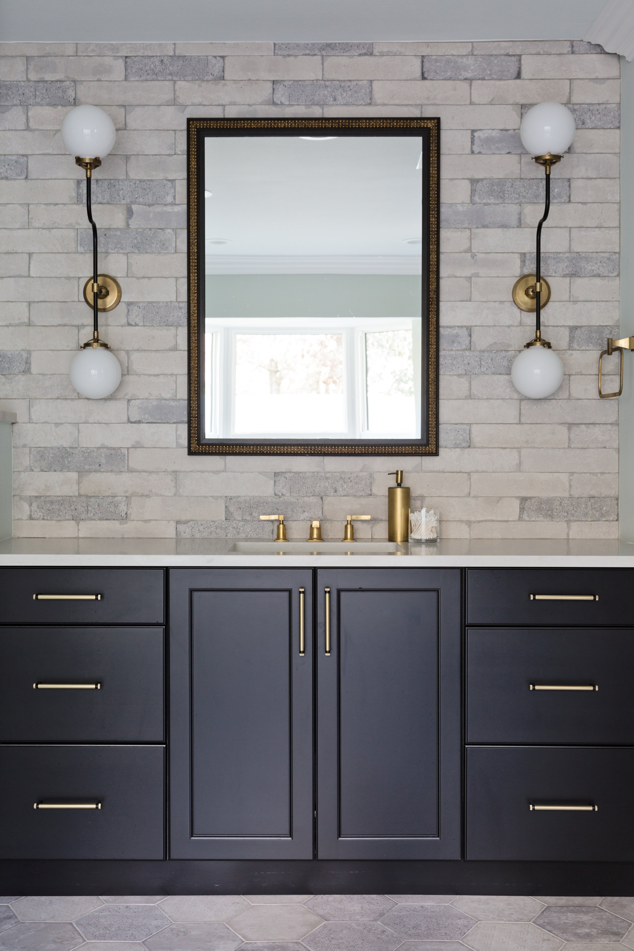 Elements of Brick, Hex, and Brass  for this Master Bathroom designed by Lisa Gilmore Design