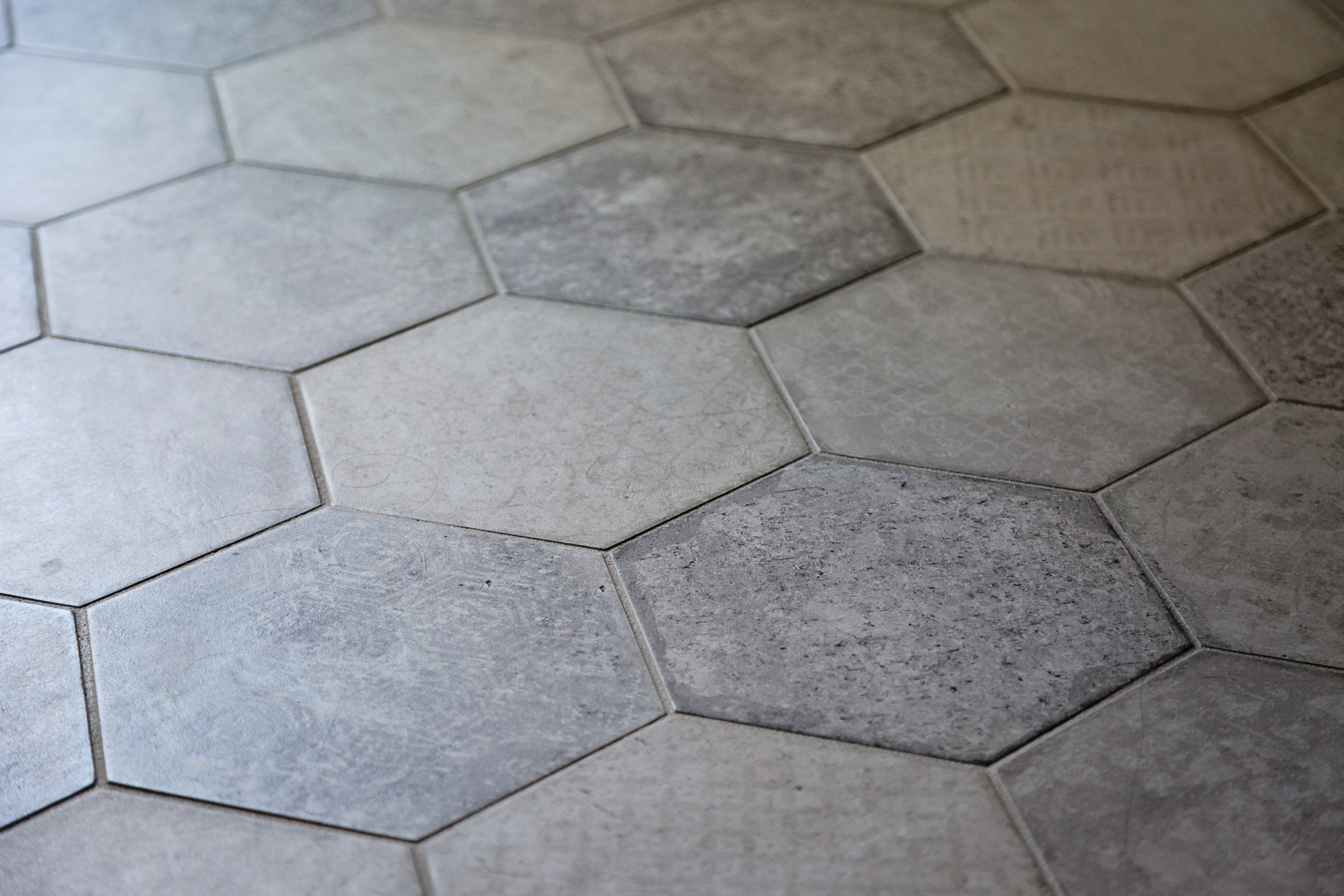 Details of Hex Porcelain Floor. The worn embossed pattern makes this bathroom timeless and classic