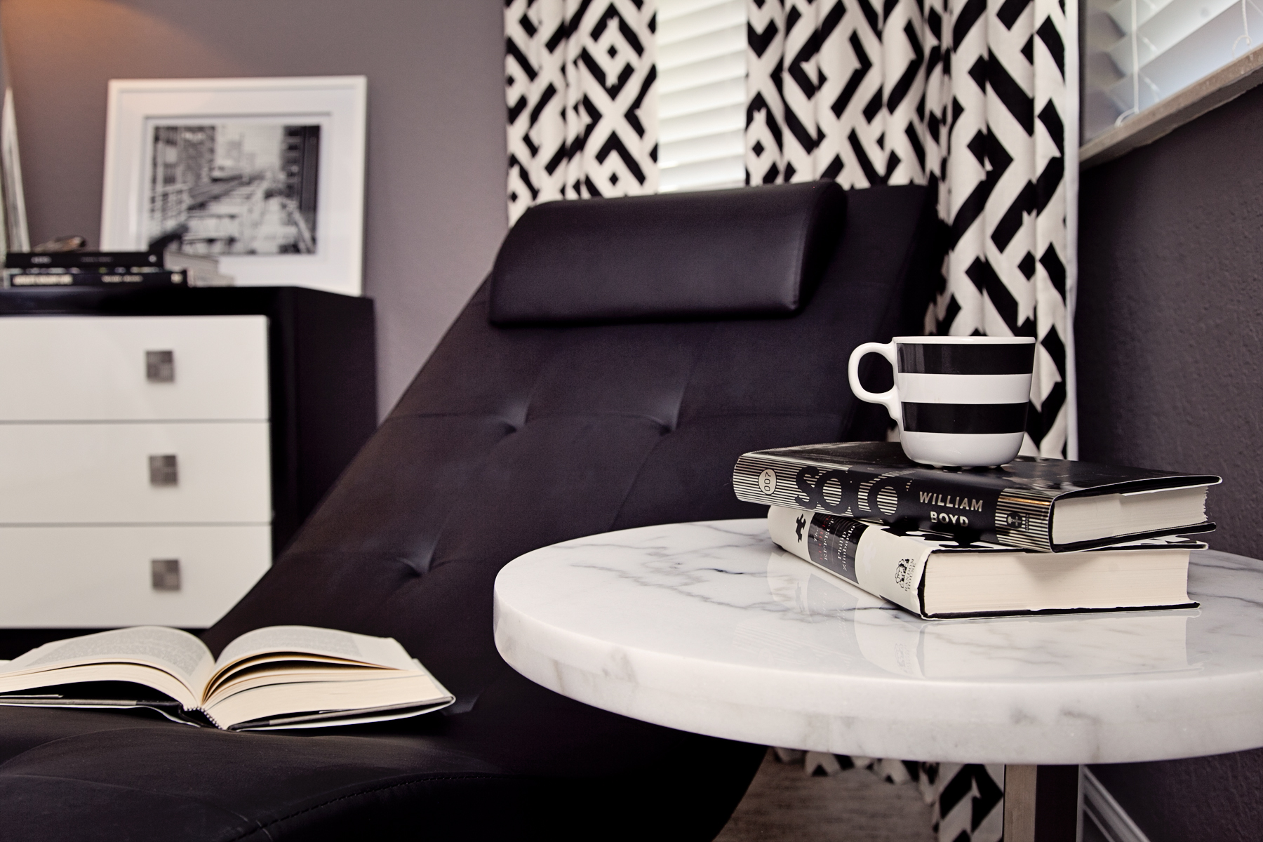 Contemporary black and white master bedroom by Lisa Gilmore Design
