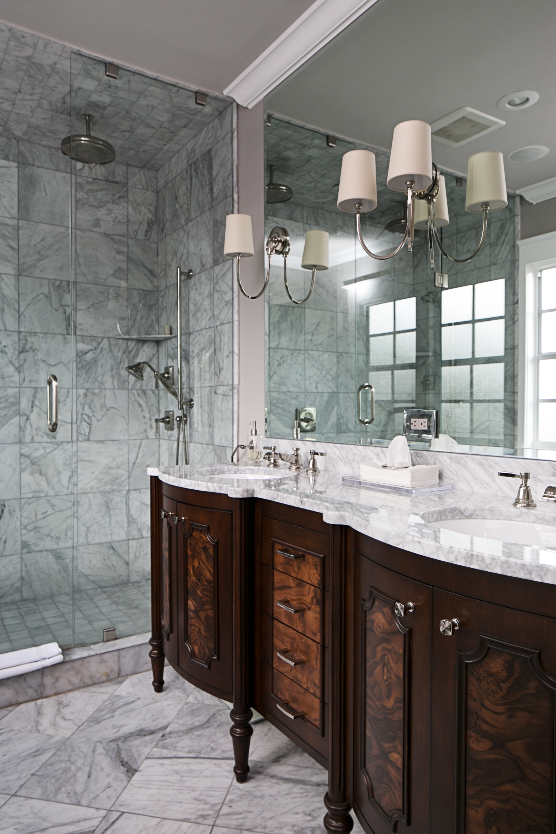 Traditional marble master bathroom by Lisa Gilmore Design | Image: Native House Photography