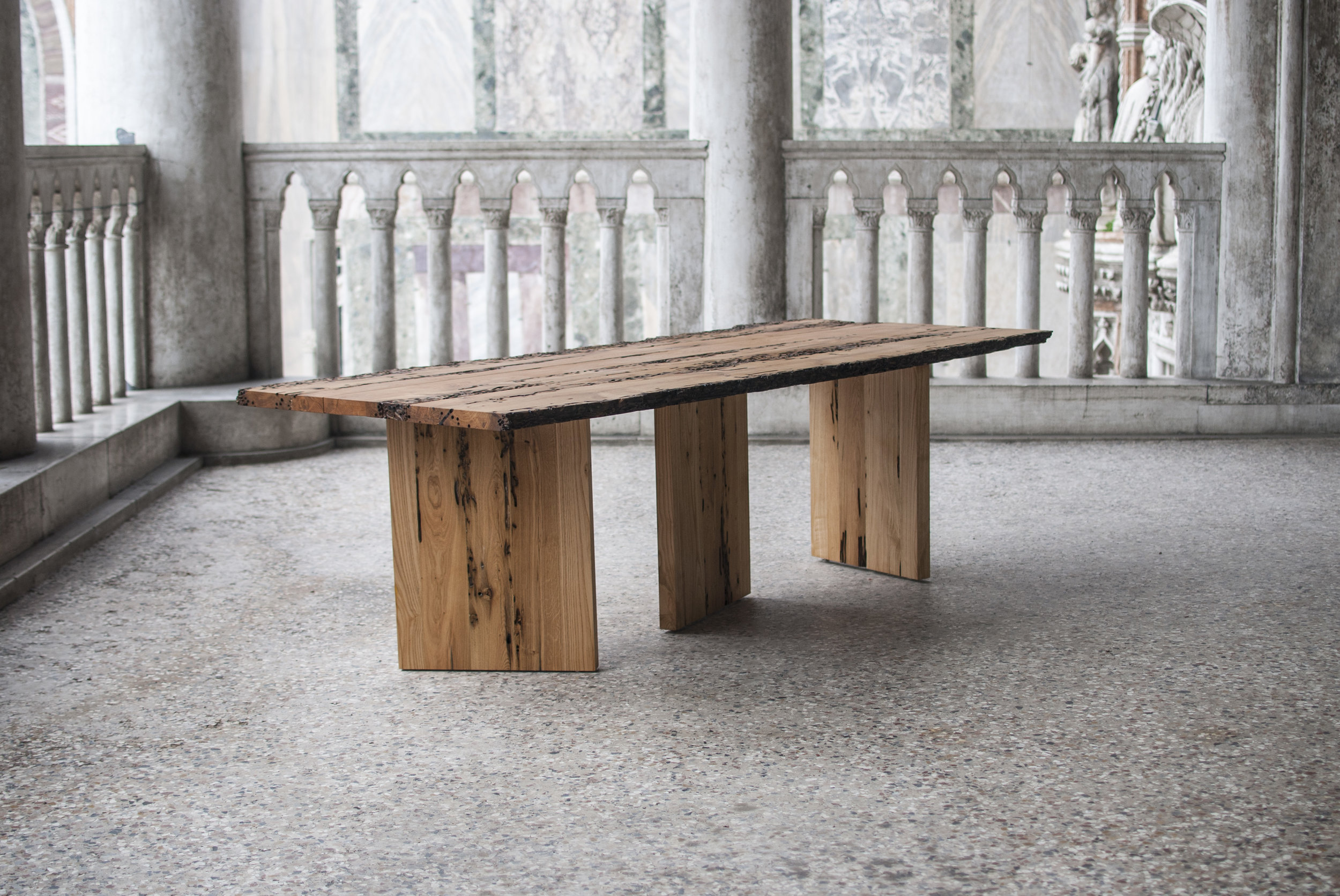 """2013 / Client:  Riva 1920 / With Cesare Bizzotto  Designed for the Briccole competition of the Italian company Riva 1920 and awarded with the first prize. Laguna is a dinner table that reuses wood from the """"bricole"""" (masts) of Venice. The table has three surfaces that are used as legs with diverse angles that give a dynamic a versatile aesthetic, just as the water in Venice."""
