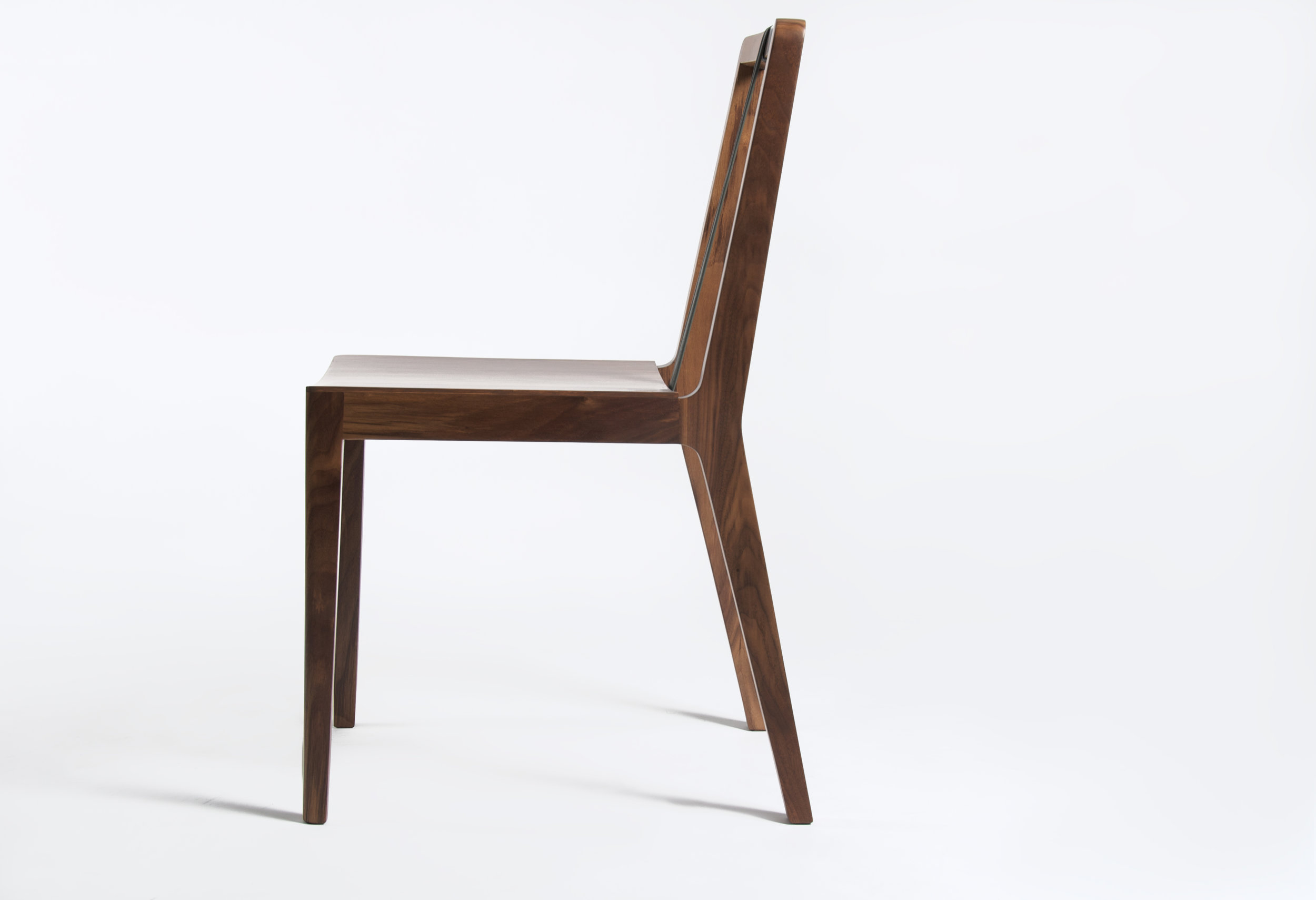 2010 / Chair / Maple, walnut, plywood, leather / Client-Producer: Bauhaus Möbel® / Awarded National Design Biennial 2011    Over time the tie and suspenders have been important symbols in fashion history. The Tie Chair uses these functional and decorative elements to acquire its own identity by using leather ribbons, this gives not only a determined aesthetic personality but also give support and security in the back area.