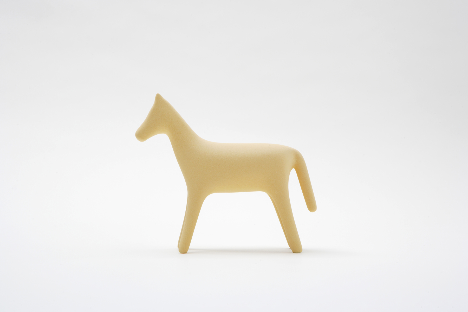 2018 / Client:    Pirwi    / Ceramics / Project assistant: Lucas Elizondo   Architect Luis Barragán had a profound esteem and fascination for horses. They influenced his work and were the central axis for some of his most valued projects. In the houses and haciendas he built, Barragán always made sure to have the presence of these beautiful animals. Horses represent Mexico with elegance in its history and its traditions. This ceramic horse, with its continuous silhouette and earthy texture, is a symbol of tradition with a contemporary language.