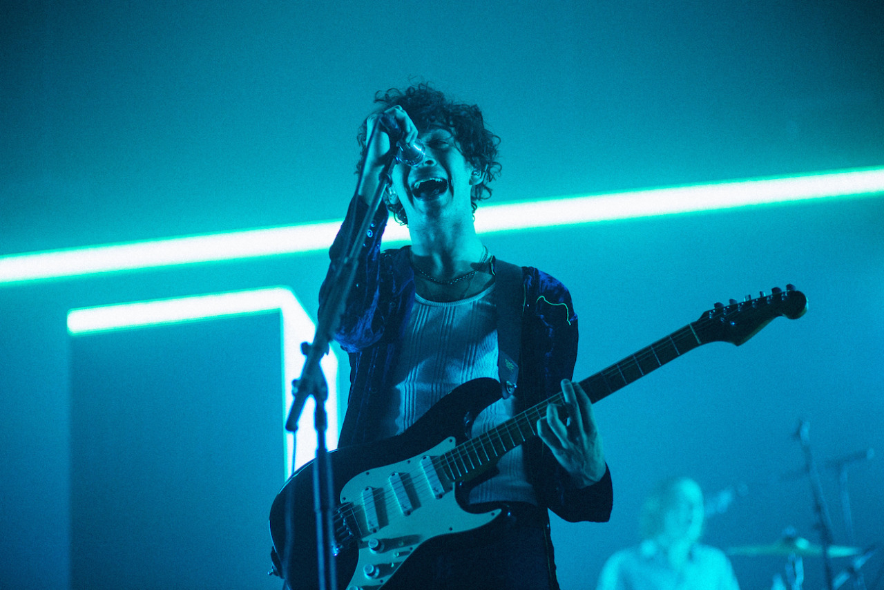 The 1975 / The 1975 Tour - Orlando, FL    How can you go wrong with shooting The 1975 when they always have the best stage presence (hitting this with a period at the end cause this is not a question, it's a fact). Back in May, I shot them in Miami and it was great except the venue was a little weird with their photo pit (there was actually a moat between the pit and stage which creates quite a bit of feet between you and the artist). After scoping out other photos of this run, I noticed this tour would have the same exact setup. It was kind of like getting a second chance to shoot the same tour  , which was cool since you know what to expect lighting wise. For this shot, I took out my 85mm which I haven't used at shows in ages. I thought these shots were a little boring at first, too clean, dead center, nothing too exciting going on in the background. In the end I decided not to delete these shots and discovered that my work needs more clean and clear images. I've always thought you needed something chaotic or extreme to make an interesting shot but I'm finally taking in the beauty of just a clean, simple still.      x