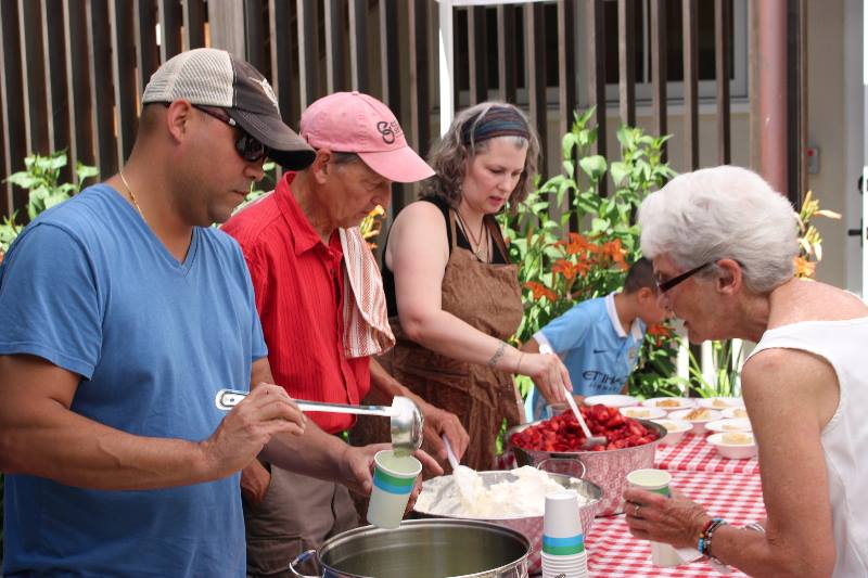 Volunteers serving strawberries at Strawberry Festival 2017