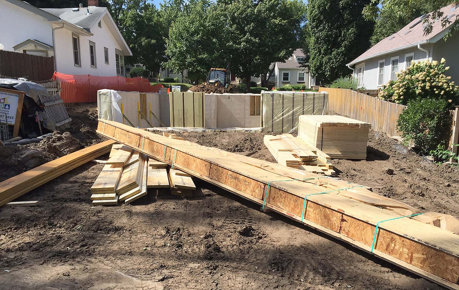 The collection includes engineered wood (LSL rim joists, LVL beams, and I joists with OSB webs), plywood sheets (subfloor),and solid lumber (treated 2x6 sill plates, 2x10 headers and dropped framing, and 2x4's for miscellaneous wall framing).