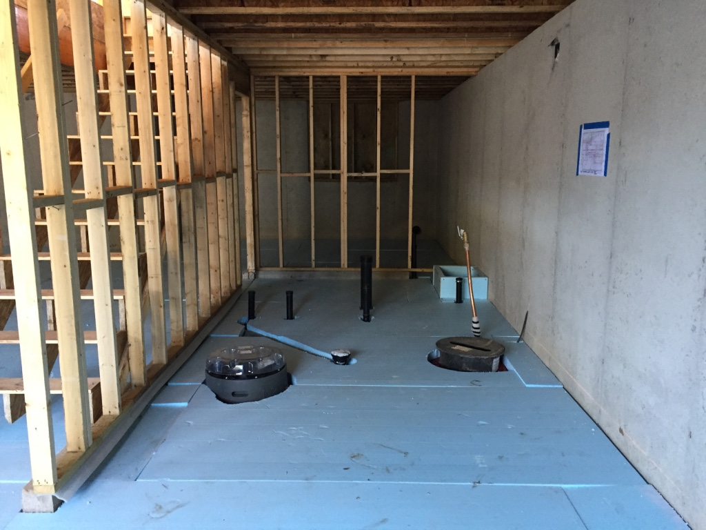The 2015 International Residential Code requires R-10 insulation below slabs in our climate zone.  We're going for 150% of insulation requirements in all envelope assemblies.  A PassiveHouse, in contrast, would probably have R-40 or greater below the floor slab.