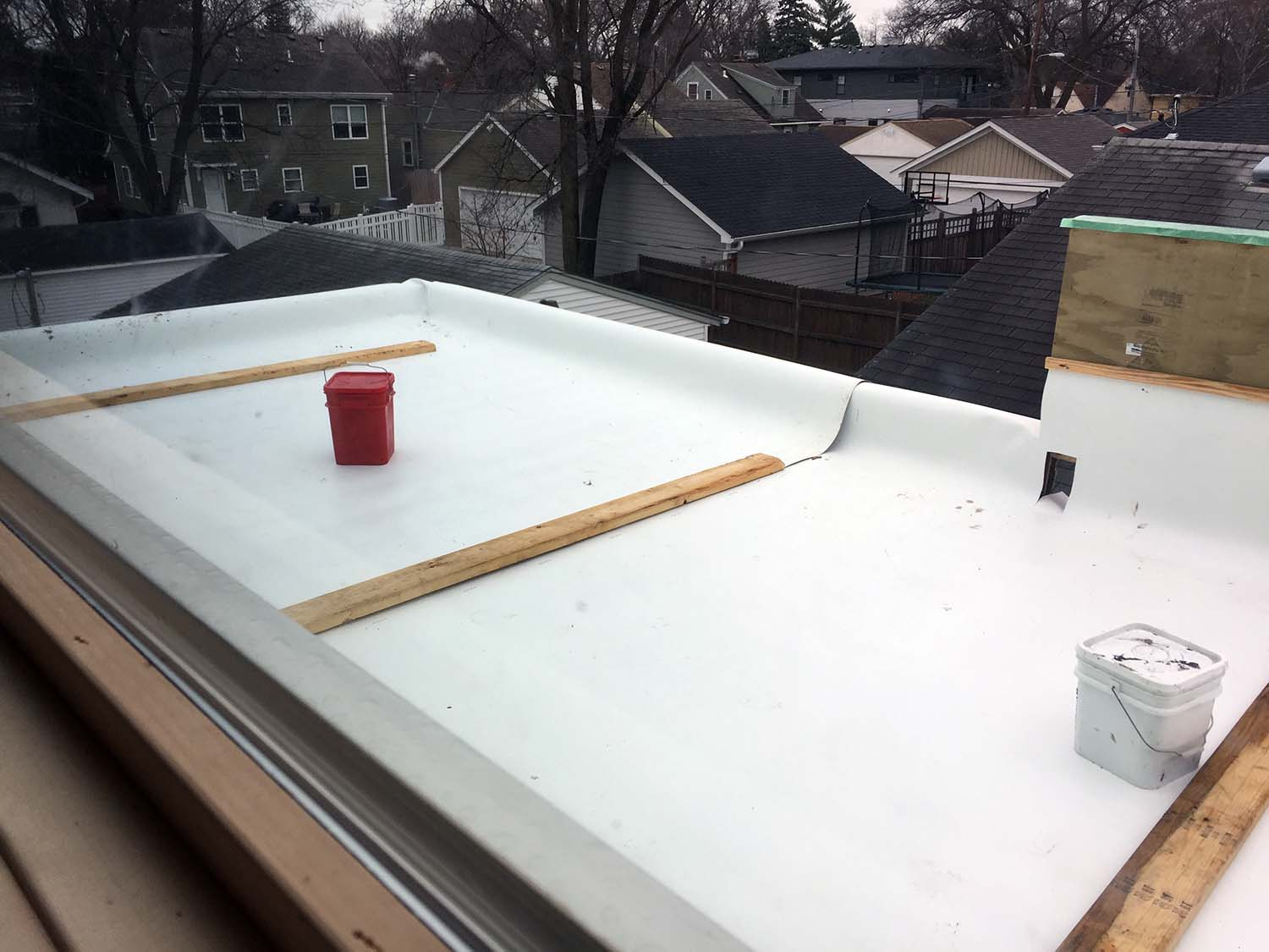 """Sheets of Thermoplastic Polyolefin membrane, pre-seam welding, cap flashing and termination bars. The white color, where not covered, will aid in minimizing heating up the immediate environment and support the idea of """"cool roofs""""."""