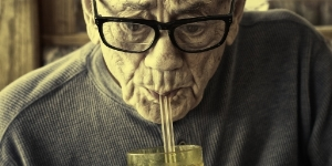 old-man-sucking-water-through-straws-picture-id185298690.jpg