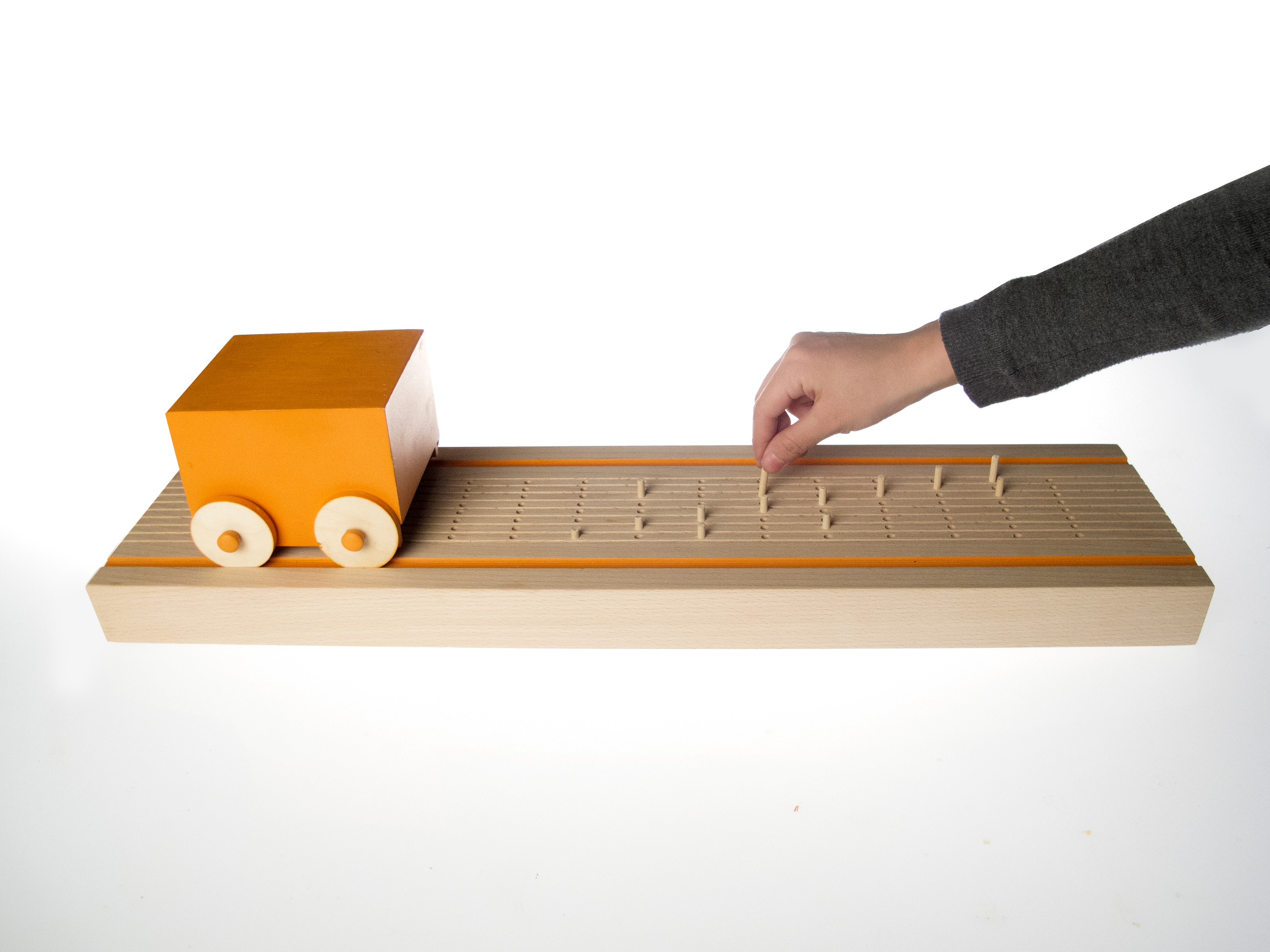 Insert pegs on track according to a full octave scale