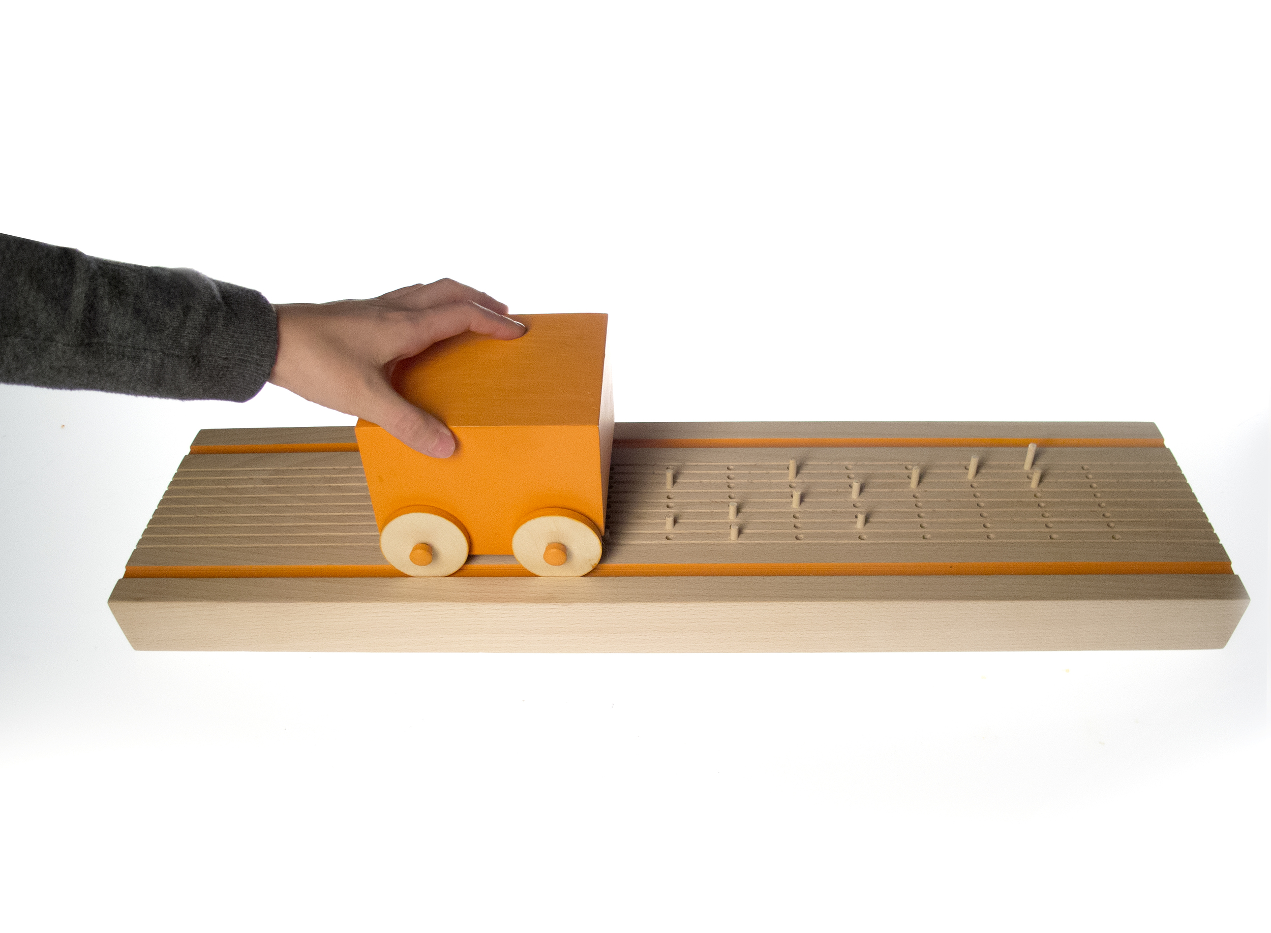 Push car along track to play composition