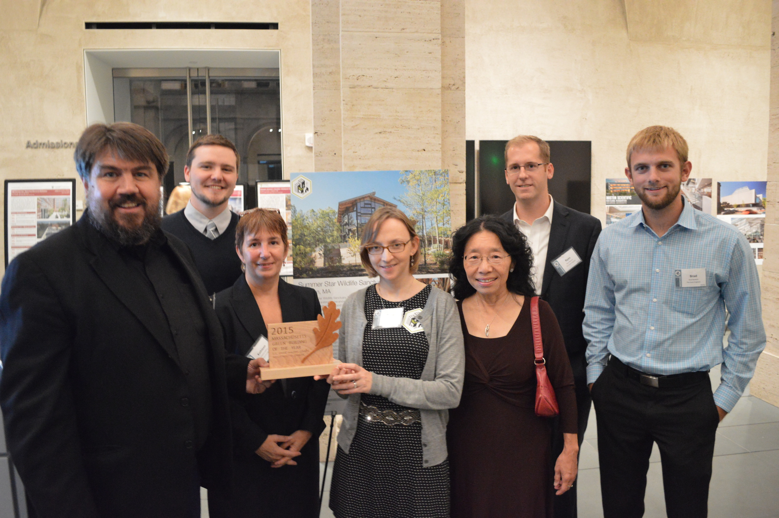 Representatives from The Green Engineer and Consigli Construction, accompanied by Project Owner, Shalin Lu (center right), proudly receive the USGBC Massachusetts 2015 Green Building Of The Year Award for the Summer Star Sanctuary Trailhead House in Boylston,MA.