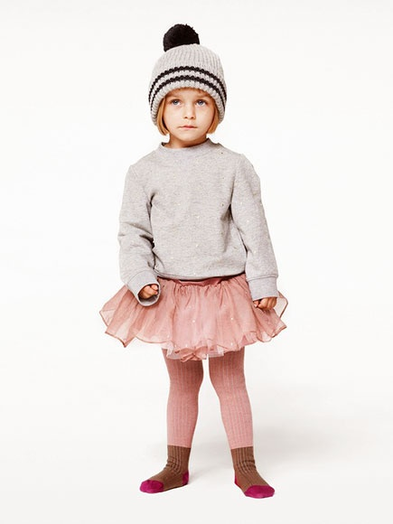 I am officially swooning… I LOVE HER! This Little Girl is Tutu Cute--outfitting her Tutu with a Pom-Pom Hat, Grey Heathered Sweatshirt, & Color-block Tights (all must have trends this winter, and will continue to be so with the frigid temperatures across the country). This  Stella McCartney Gold Dot Tulle Party Skirt  is also available in  Honey and is an adorable Tulle party Skirt featuring embroidered Bow Appliqué in Pale Pink- perfect for Spring.