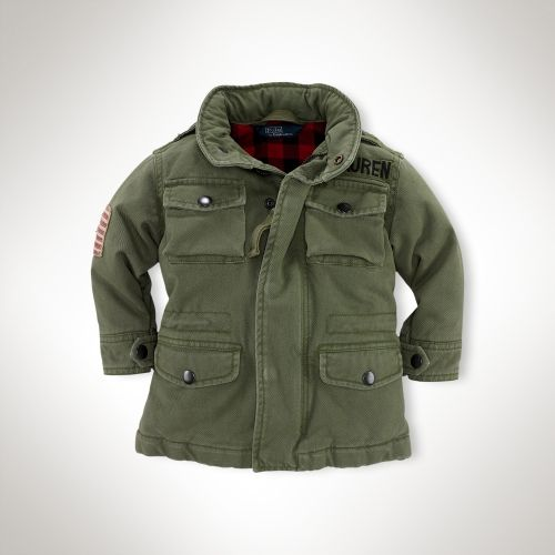 This  Ralph Lauren Cotton Flag Field Jacket is a ruggedly handsome Army Jacket with plaid lining, a distressed flag patch at the arm, embroidery above the left pocket, epaulets, and a stowaway hood.
