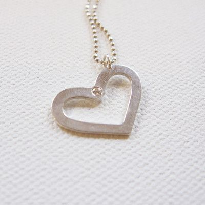 This  Tomoko Kanashima Heart Necklace  is the perfect gift for a special occasion, whether it be your daughters birthday, first communion, a flower girl gift, or Valentine's day. This Charming Heart Necklace is Sterling Silver with a Diamond for your Little Princess.I love the simplicity of an open heart necklace, and this one is simply perfect.