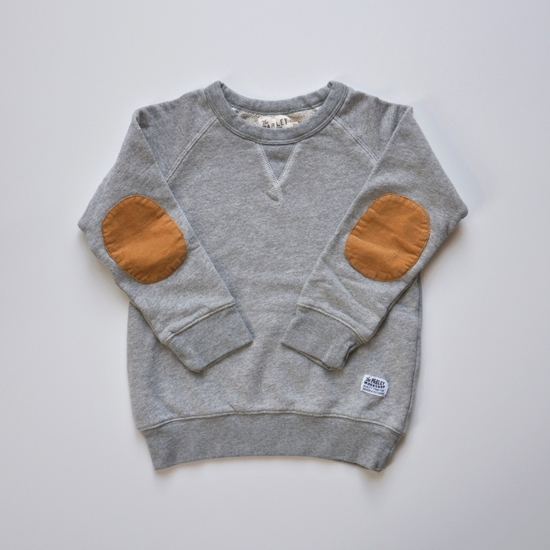 From Yarnmade, this  Parley Workshop All-Day Sweatshirt is the perfect every-day sweatshirt. It is made from soft premium french terry with corduroy elbow patches and a small handmade label on front. This is truly a lux Grey Heather Sweatshirt for your Little One!