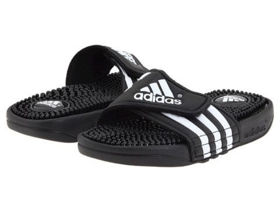 The  Adidas Kids Adissage K Core gives your little one's feet the comfort that they deserve. It is a basic open toe Slide with single band upper that is adjustable with hook-and-loop flap for a custom secure fit. The footbed also has massaging nubs to keep their feet feeling great-- these as some seriously comfortable Shower Slides!
