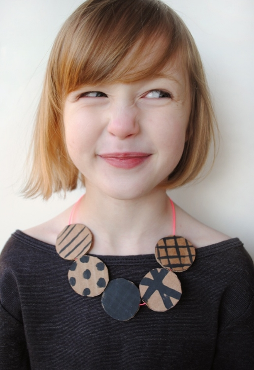 I Love this  minted.com DIY REVERSIBLE CARDBOARD NECKLACE FOR KIDS , because who says you need to spend a lot of money to be fashionable?With just a bit of cardboard, some paint and a bit of string, your little one can make their very own Statement Making Necklace. Minted.com has a very thorough tutorial with pictures that is an easy to follow project for you and your little one to enjoy doing together!