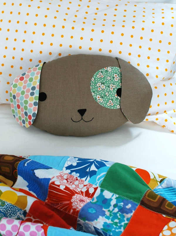 At  crafts.tutsplus.com there is a tutorial to  Sew a Cute Puppy Pillow Softie by Lisa Tilse. The website has a free downloadable pattern and step by step instructions with photos. Little ones will love cuddling up to this special pillow especially since it's handmade with love.