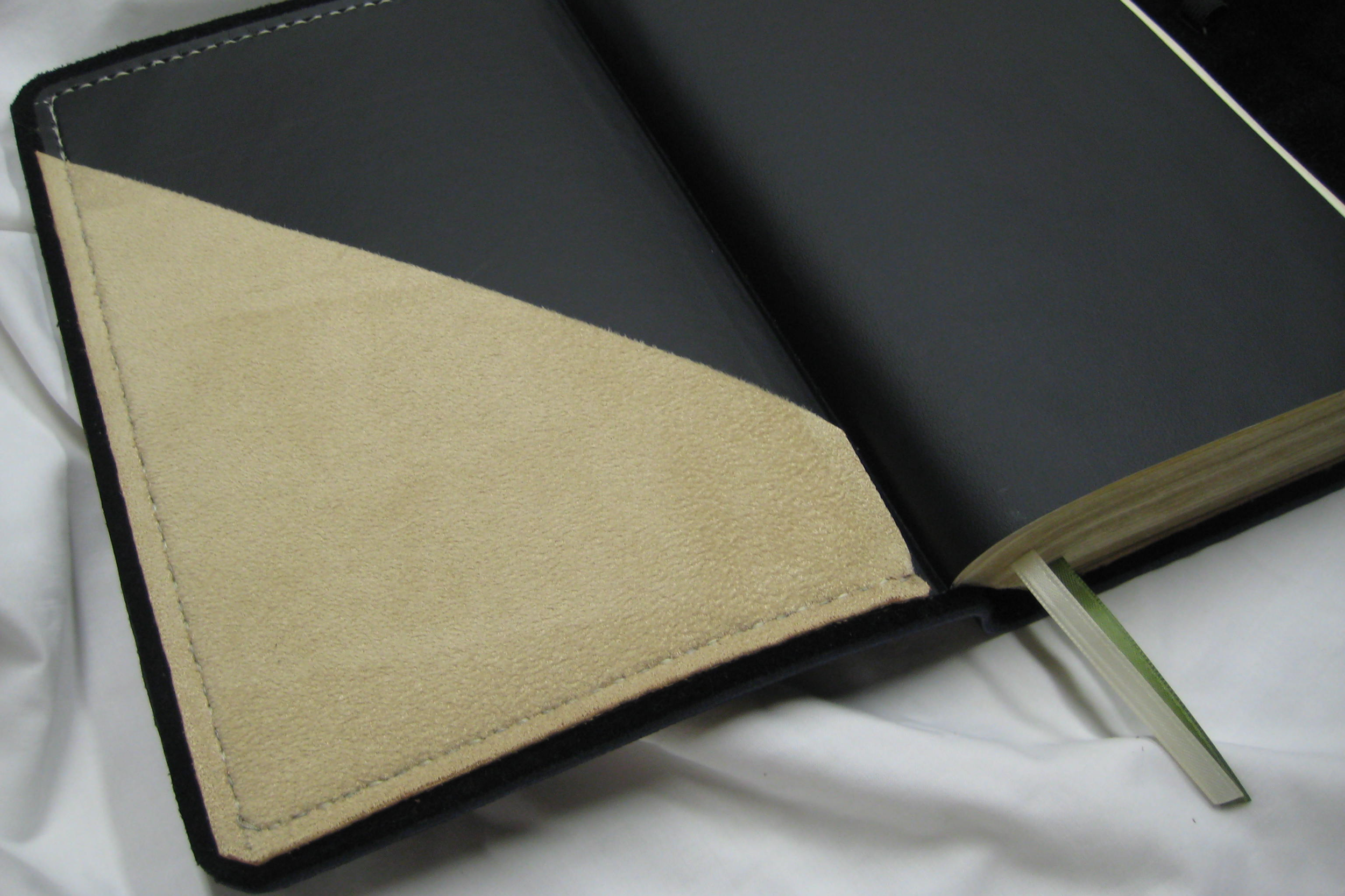 Pockets : Hand built fabric suede pockets on the inside of the front, back or both covers. A low profile and convenient way to keep a few loose papers with your Bible.