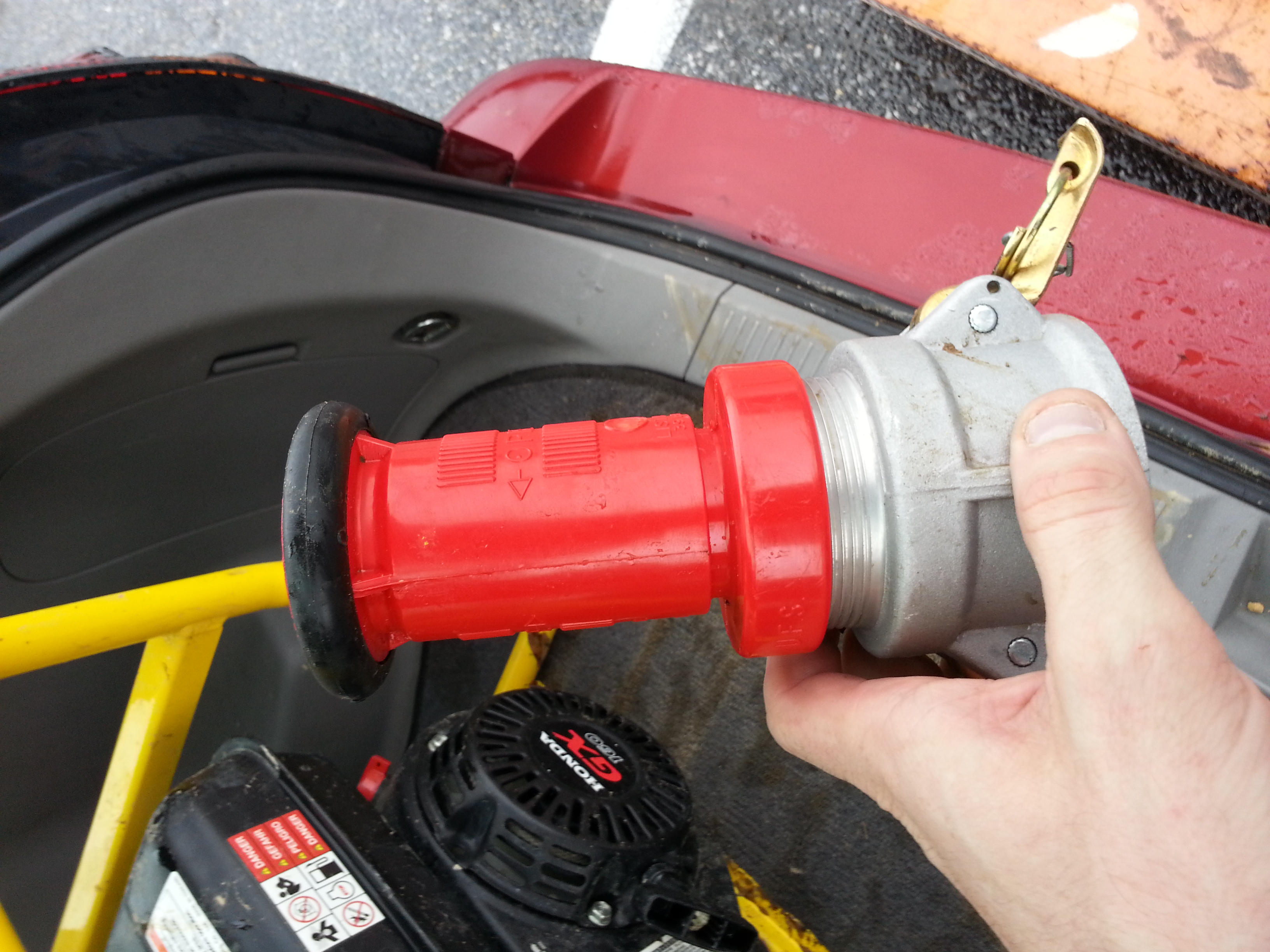 Fire hose nozzle with cam lock adapter attached