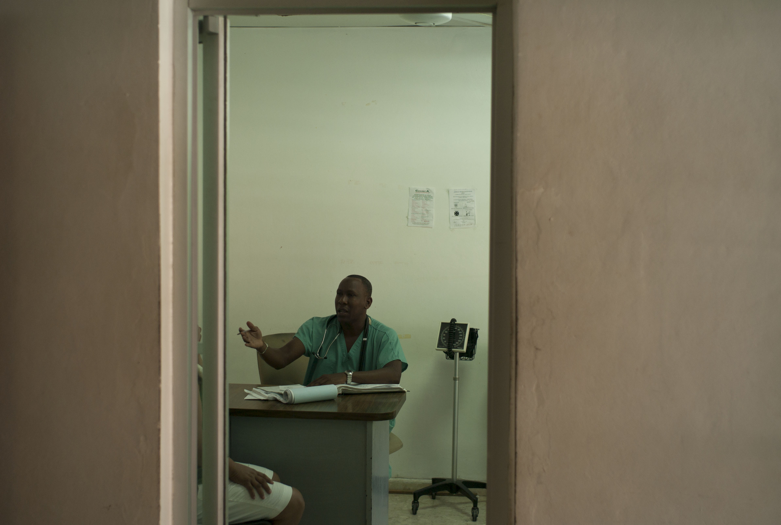 A doctor talks with a patient,  Paraiso, Dominican Republic.