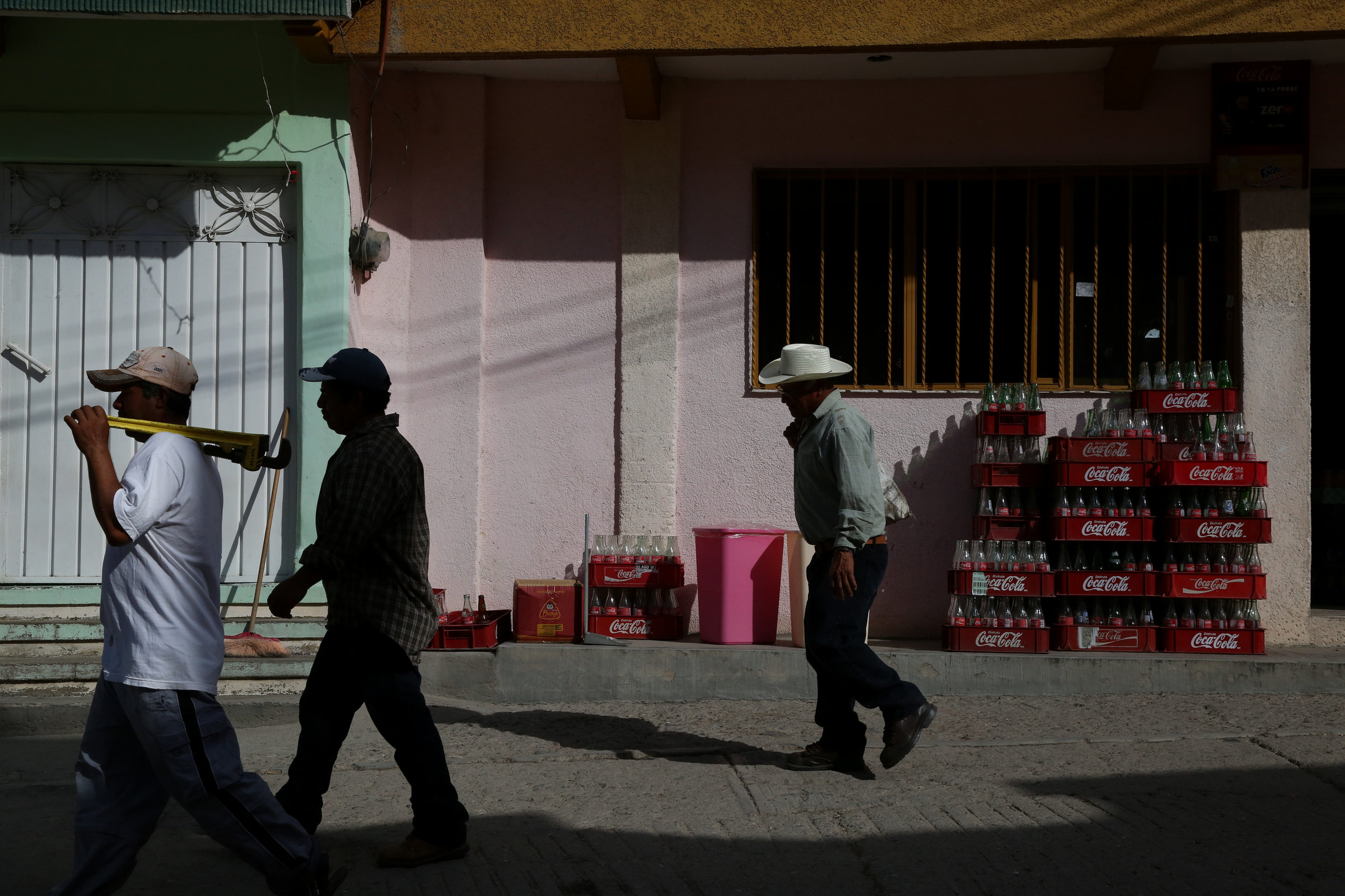 Day laborers walk to work in  San Miguel Allende, Oaxaca.