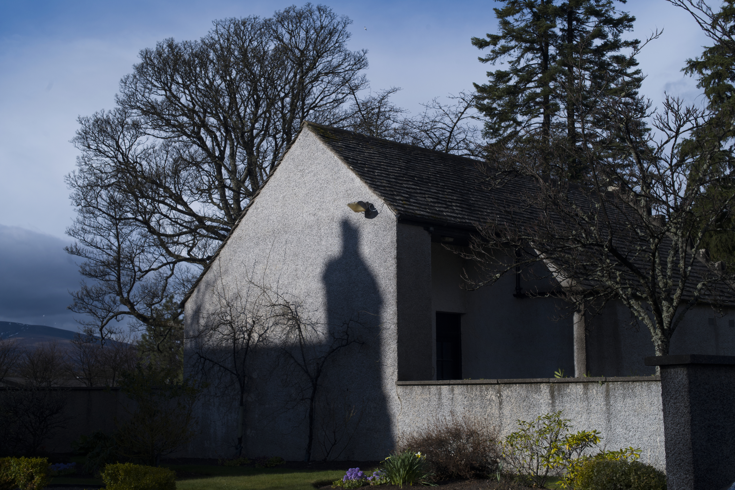 The shadow of Easter Elchies House falls on the gardens at The Macallan