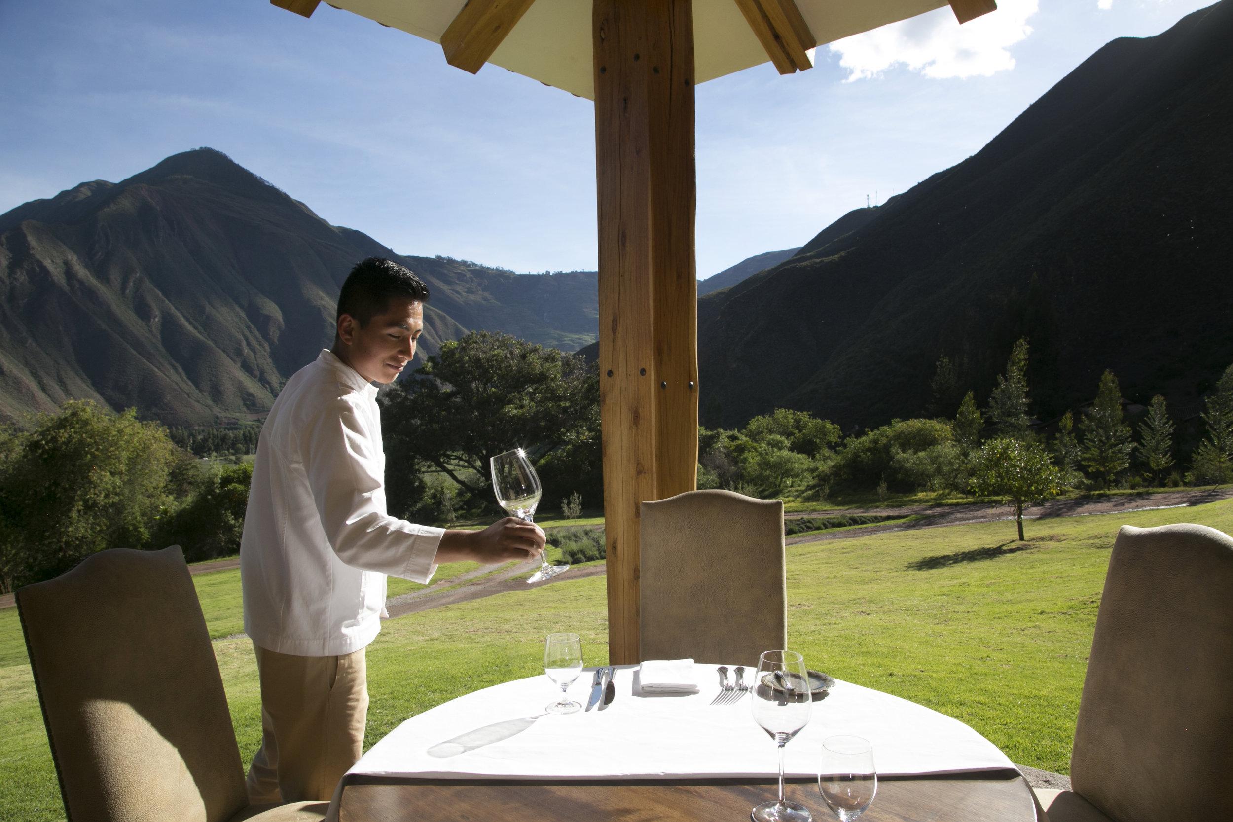 A waiter sets the table at Inkaterra's Hacienda Urubamba.